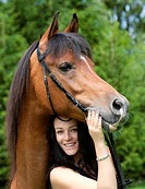 young woman and Arabian horse