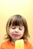 Young girl eating a frozen ice pop