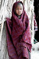 Child wrapped in blanket, Watatulu tribesmen of Miyuguyu, Shinyanga district, Tanzania