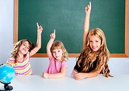 kids student clever girls group in classroom raising hand finger with blackboard