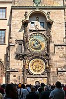 Tourists waiting in front of the Astronomical Clock on the procession of the twelve apostles, Old Town Square, Old Town, Prague, Bohemia, Czech Republ...