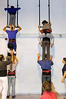 Castellers de la Vila de Gracia training ´Castellers´ building human tower, a Catalan tradition Headquarters of Castellers de la Vila de Gracia Barcel...