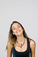 Studio shot of young woman, smiling