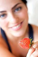 Healthy eating. Woman eating a strawberry.