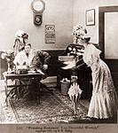 PRESSING BUSINESS YOU DECIETFUL WRETCH Is the caption to a photo of a woman surprising husband who is embracing secretary in his office. Ca. 1907. BSL...