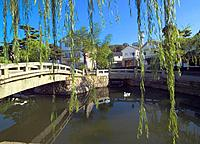 Bridge over the river and houses in Kurashiki, Okayama Prefecture, Japan