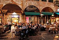 Italy, Veneto, Verona, Piazza delle Erbe, restaurants at dusk