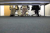 Legs of businesspeople having a meeting