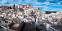 Aerial view of ancient town of Matera with tufa houses, sunny spring afternoon with blue sky, Puglia, Southern Italy,