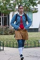 Cuba, Havana  Cuba´s Young Generation  Teenage Girl going to School  Ochre-yellow pants or skirt indicate secondary school level