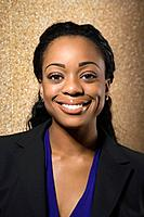 Attractive African American businesswoman smiling at viewer.