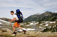 A man hiking with a backpack along a beautiful section of trail