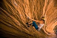 A woman bouldering near Moab, Utah