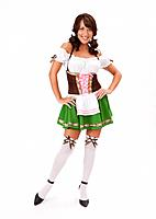 Portrait of young woman wearing Oktoberfest costume, studio shot