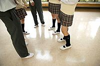 High school students talking in corridor, Japan