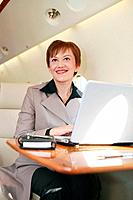 Businesswoman working on private jet