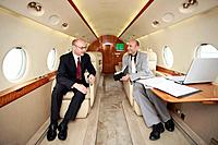 Businessmen working in private jet