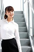 Portrait of businesswoman at staircase, smiling