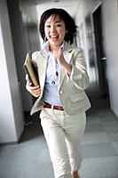 Businesswoman Running in Corridor