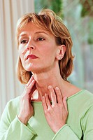 Woman palpating her throat