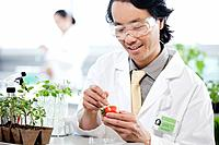 Male scientist working with plants in laboratory
