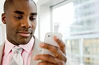 Close up of businessman texting on cell phone