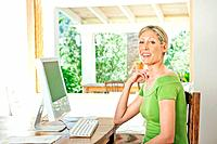 Woman using computer at desk