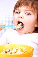 Baby girl being spoon_fed in high chair