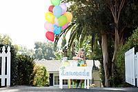 Girl 5_6 selling lemonade in front of house