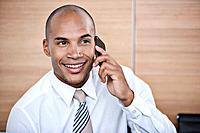 Portrait of smiling businessman talking via cell phone
