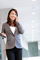 A business woman talking on the phone