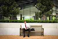 Businessman reading in courtyard