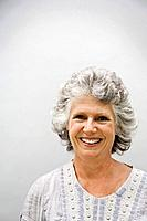 Studio portrait of smiling senior woman (thumbnail)