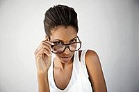 Studio portrait of beautiful woman wearing big glasses