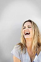 Portrait of laughing woman, studio shot