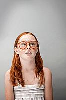 Portrait of redhead girl 7_9 wearing glasses, studio shot