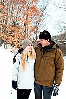 Mid adult couple in snow (thumbnail)