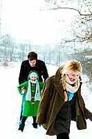 Family walking in snow (thumbnail)