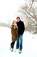 Portrait of mid adult couple in snow