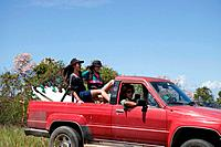Three young friends driving off road vehicle on vacation