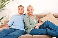Mature couple sitting on sofa