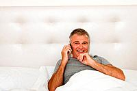 Man in bed on cellphone