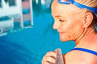 Mature woman by swimming pool