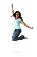 Beautiful happy smiling African Caribbean teenager jumping from happiness to celebrate, wearing blue shirt and jeans, isolated