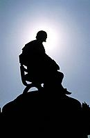 Silhouette of statue of Shakespeare.