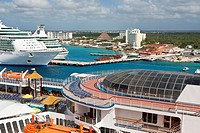 Carnival Ecstacy and two Royal Caribbean cruize ships at port in Cozumel, Mexico in the Caribbean Sea