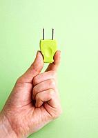 Hand holding plug