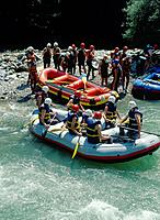White_water rafting on River Dranse. Inflatable dinghies. People in safety gear/ helmets and life jackets.