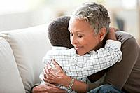 Grandmother comforting grandson