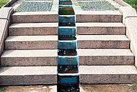 water flowing between steps in garden